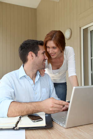 selfemployed: Self-employed man working at home with wife