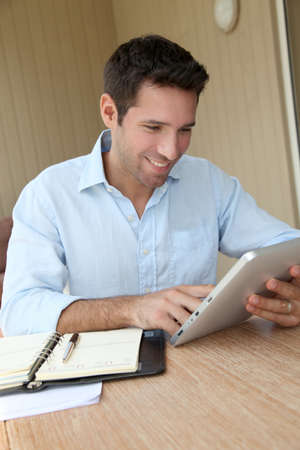 Man working at home with electronic tablet Stock Photo - 9478966