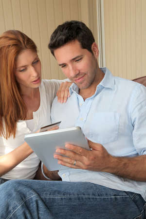 online transaction: Couple doing online shopping with electronic tablet