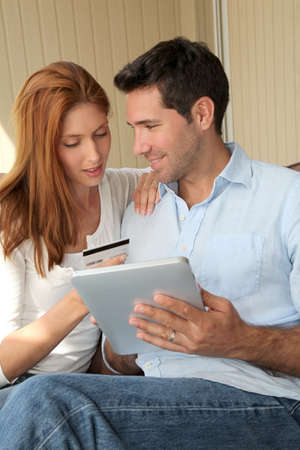 Couple doing online shopping with electronic tablet Stock Photo - 9480171
