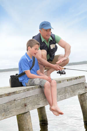 Father and son fishing in lake Stock Photo - 9479981