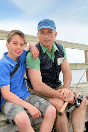 flyfishing: Father and son fishing in lake