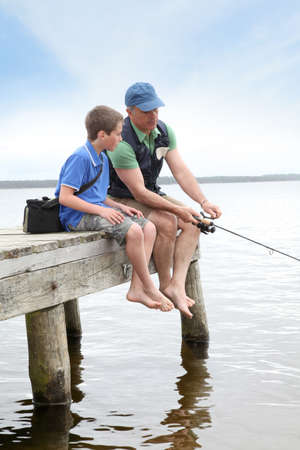 Father and son fishing in lake Stock Photo - 9479491