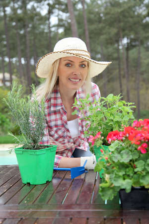 Portrait of beautiful blond woman with aromatic plants photo