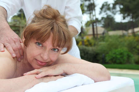 woman laying: Portrait of senior woman laying on a massage bed