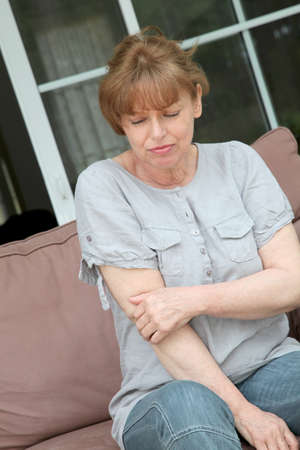 articulation: Senior woman with osteoarthritis pain