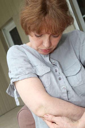 articulation: Senior woman with osteoarthritis pain