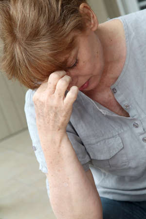 Senior woman having a headache Stock Photo - 9479237