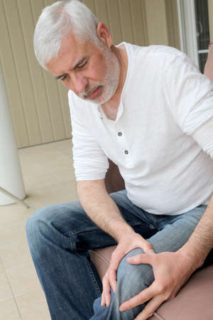 arthritis pain: Senior man with osteoarthritis pain