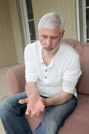 Senior man with osteoarthritis pain photo