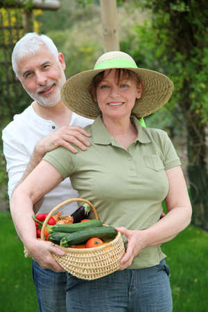 Senior couple standing in kitchen garden Stock Photo - 9479978