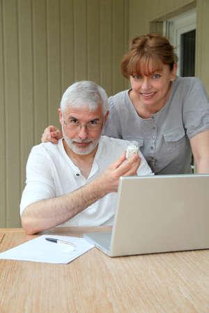 Senior couple checking medical information on internet Stock Photo - 9479299