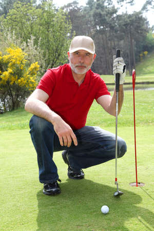 golfing: Senior man on golf course Stock Photo