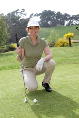 Portrait of senior woman on golf course photo