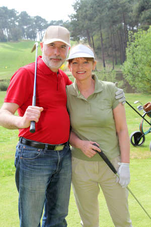 Senior people on golf course Stock Photo - 9480140