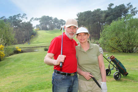 Senior people on golf course Stock Photo - 9479739