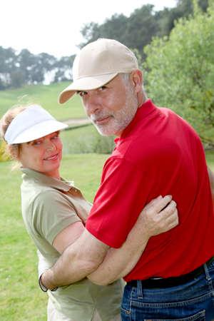 Senior people on golf course photo