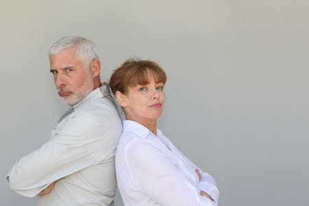 Portrait of senior couple upset at each other photo
