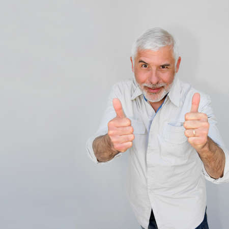 Senior man with thumbs up photo