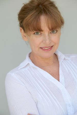Portrait of smiling senior woman on white background Stock Photo - 9478908