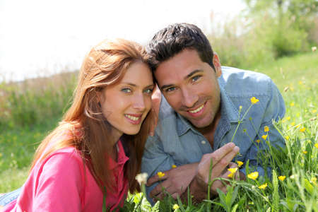 Couple of lovers laying donw in park Stock Photo - 9479663