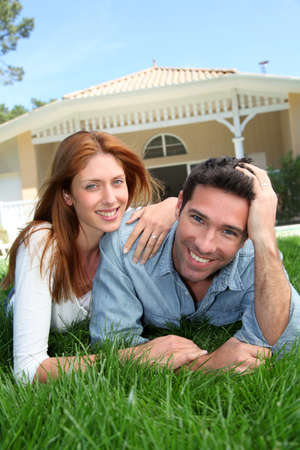 Happy couple laying down in their home garden Stock Photo - 9784524