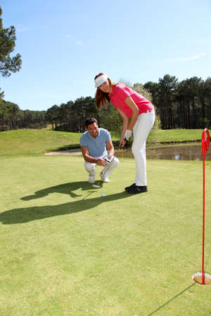 playing golf: Woman learning how to play golf