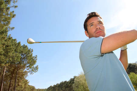 Portrait of golfer playing in summertime photo
