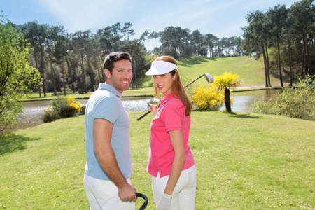 golfing: Couple playing golf on a sunny day