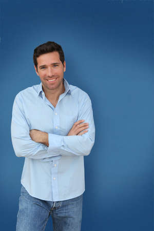 30 years old man: Portrait of handsome man standing on blue background Stock Photo