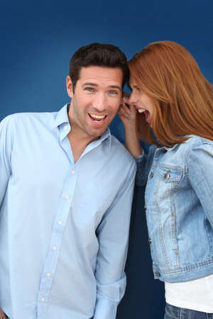 Woman pulling on her boyfriend's ears 스톡 콘텐츠
