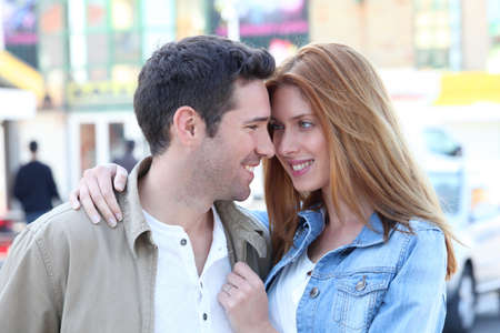 Happy couple doing shopping in town Stock Photo - 9480357