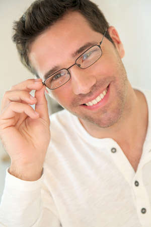 Portrait of handsome man with eyeglasses photo