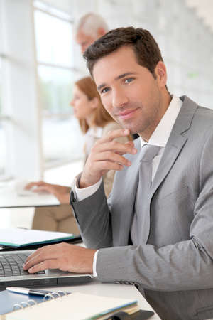 Businessman working on laptop computer Stock Photo - 9480804