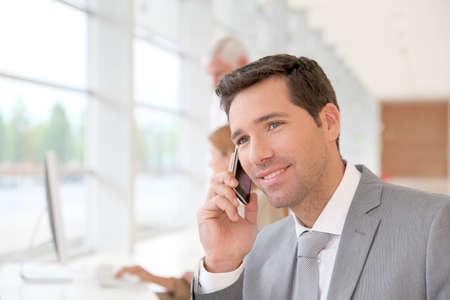 Businessman talking on the phone Stock Photo - 9480588