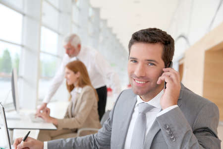 sales person: Businessman talking on the phone