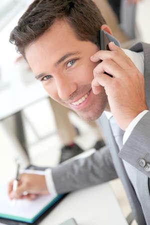 Businessman talking on the phone Stock Photo - 9480554