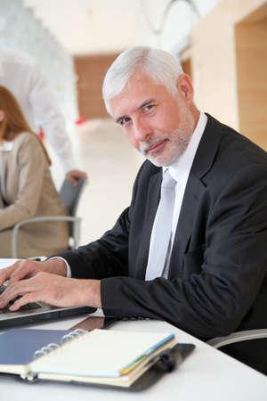 Senior businessman working on laptop computer Stock Photo - 9480587