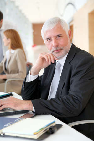 Senior businessman working on laptop computer Stock Photo - 9480600