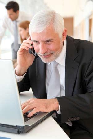 Senior businessman at work Stock Photo - 9480576