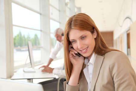 Beautiful businesswoman talking on the phone photo