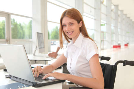 Handicapped woman in office photo