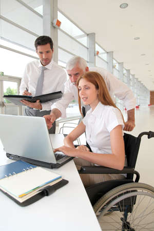 Handicapped woman attending a meeting in office photo