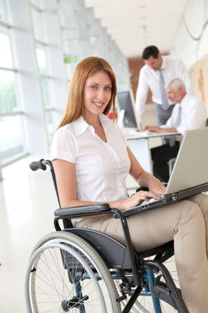 social worker: Businesswoman in wheelchair at work Stock Photo