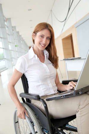 disabled person: Businesswoman in wheelchair at work Stock Photo