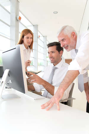 Office workers with manager in a meeting Stock Photo - 9480493