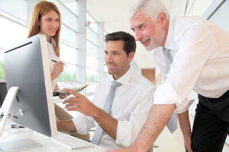 computer office: Office workers with manager in a meeting