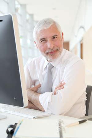 Senior businessman working in office photo