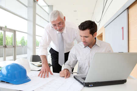 construction manager: Architects working on planning Stock Photo