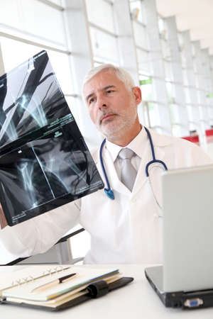 Senior doctor checking xray results photo